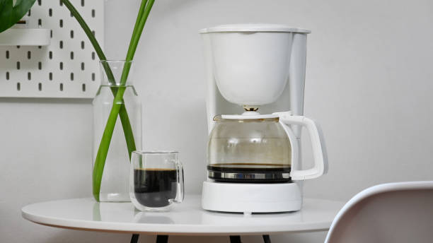 Coffee machine and coffee cup in office room. stock photo