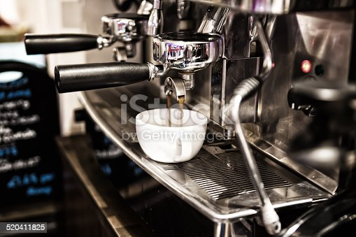 An artistic image of coffee being poured into a cup in a Bistro Restaurant
