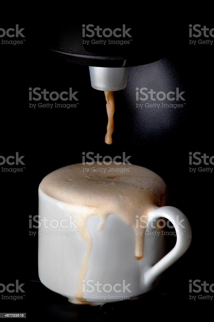 Coffee machine pouring coffee stock photo