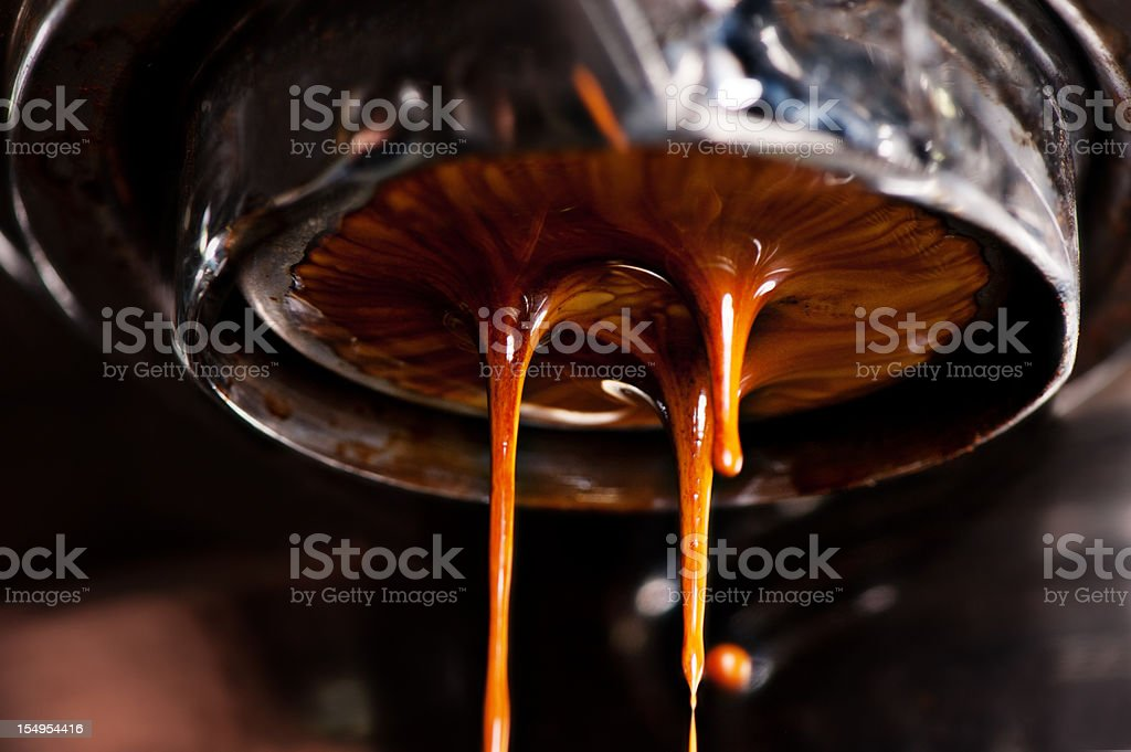 Coffee machine pouring out a cappacino stock photo