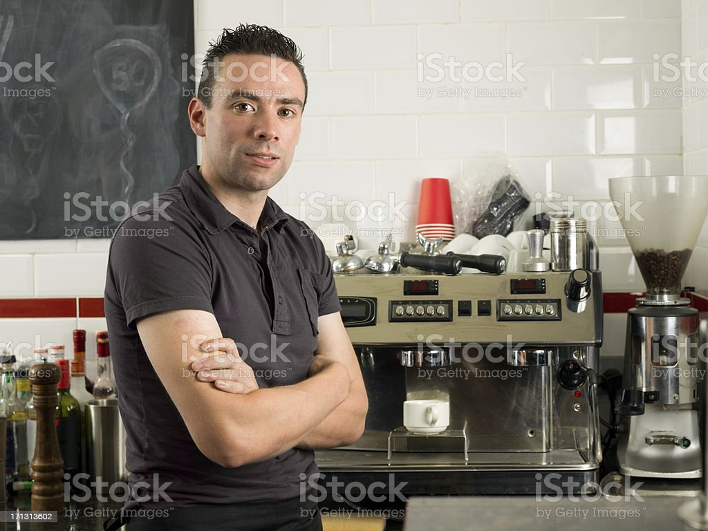 Coffee machine with an employee royalty-free stock photo