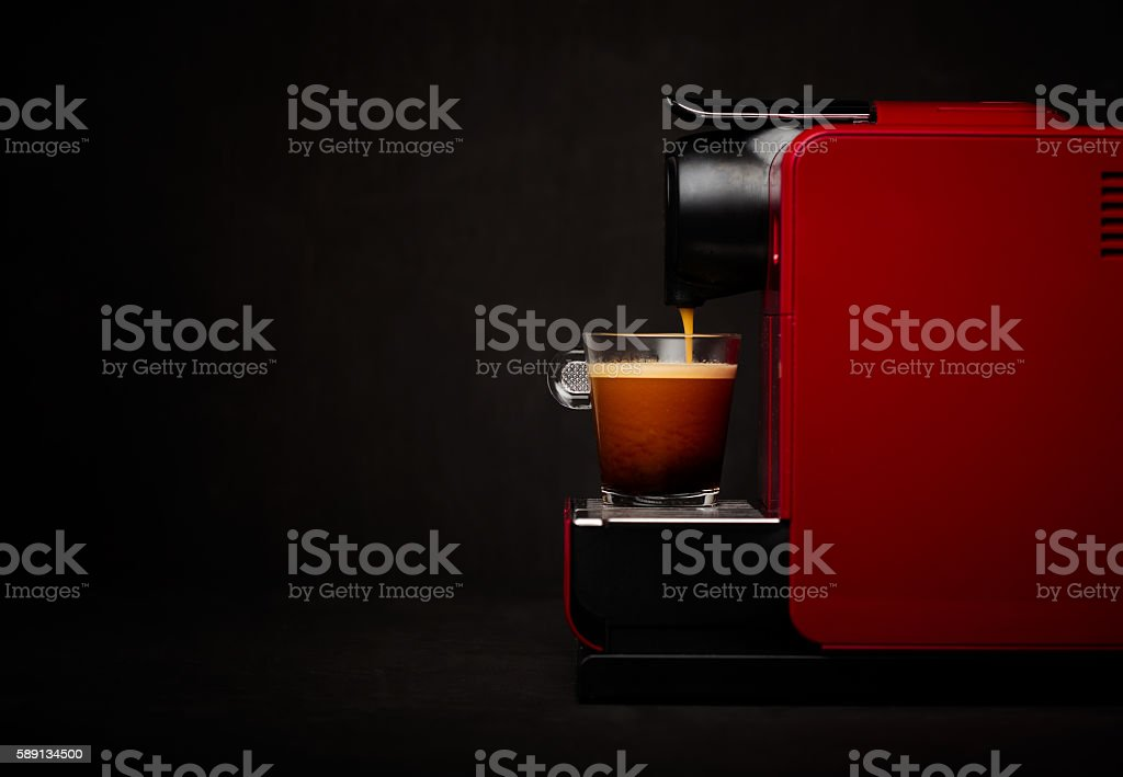 Coffee machine with cup of coffee stock photo