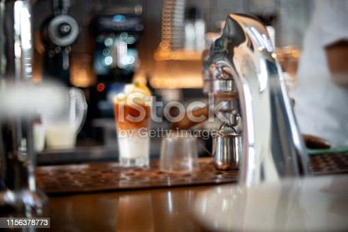 istock Coffee maker head in the coffee 1156378773