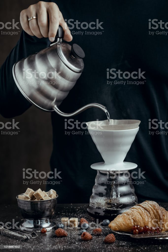 Pouring hot water in coffee maker