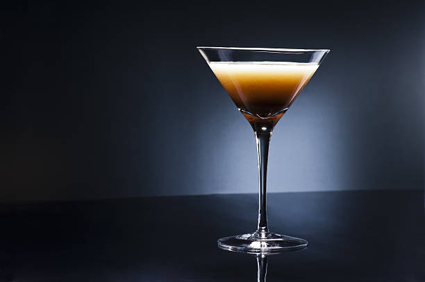 Coffee Martini Coffee Martini cocktail in front of disco lights martini stock pictures, royalty-free photos & images