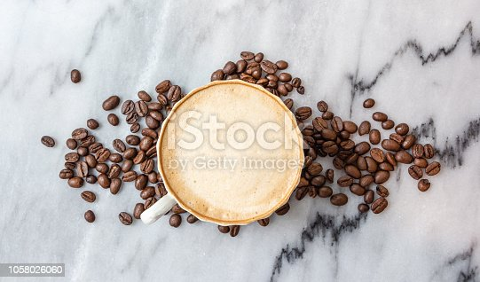 istock Coffee milk in a cup on marble table. 1058026060