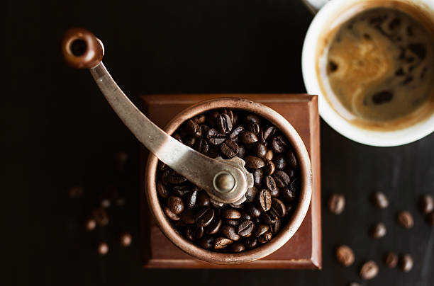 Coffee mill with coffee beans stock photo