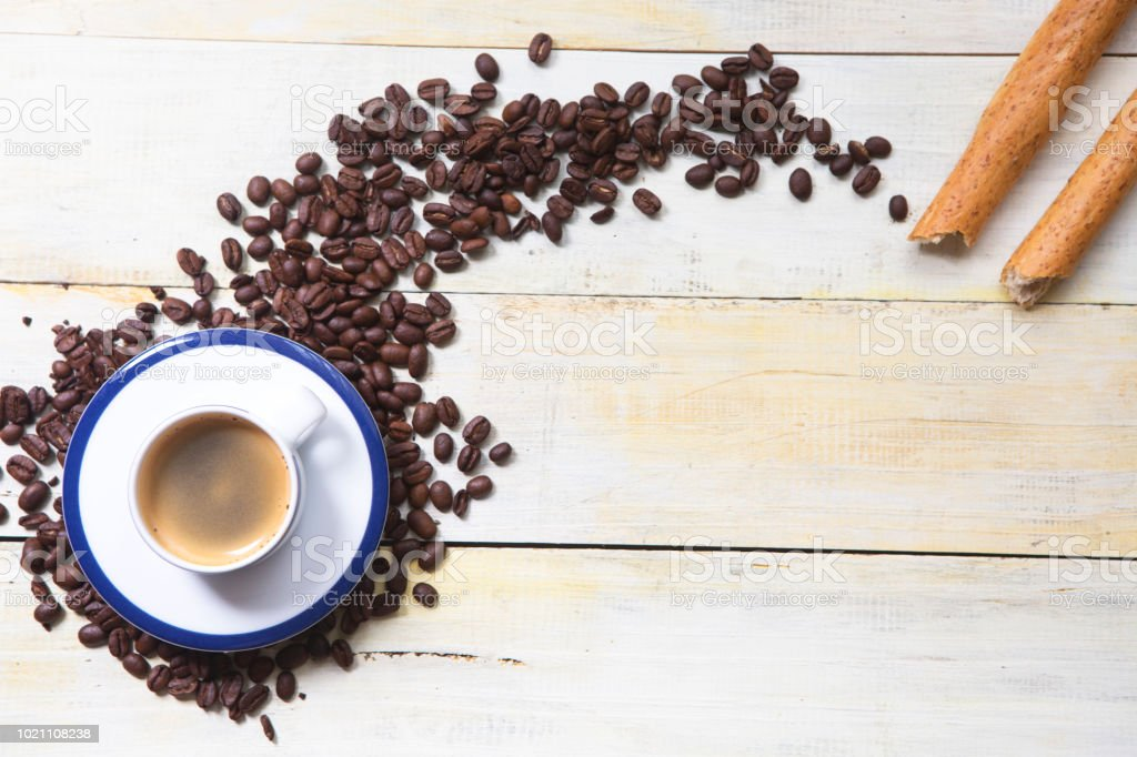 Coffee Mug and Beans on grunge wooden background stock photo