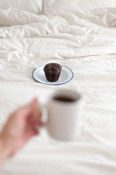 Coffee mug and chocolate muffin stock photo