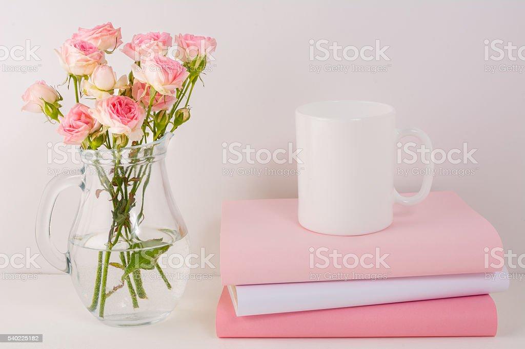 Coffee mug mockup with pink roses