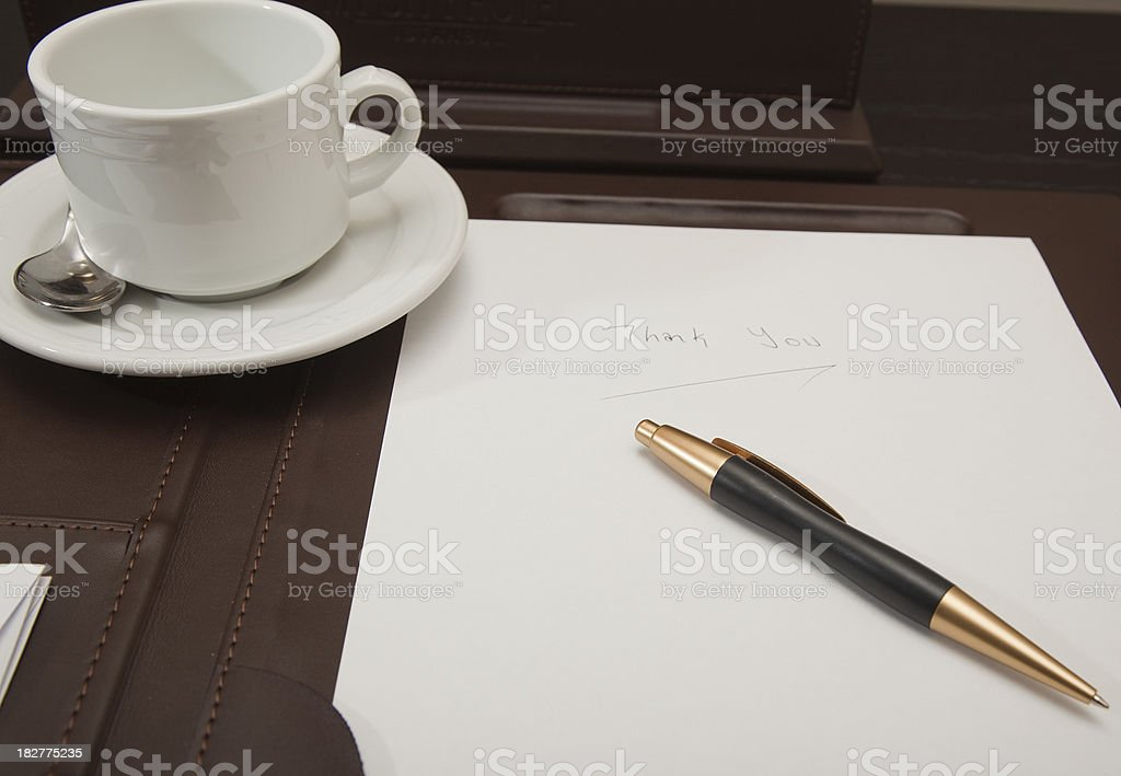 Coffee mug, notebook and  pen on desk pad royalty-free stock photo
