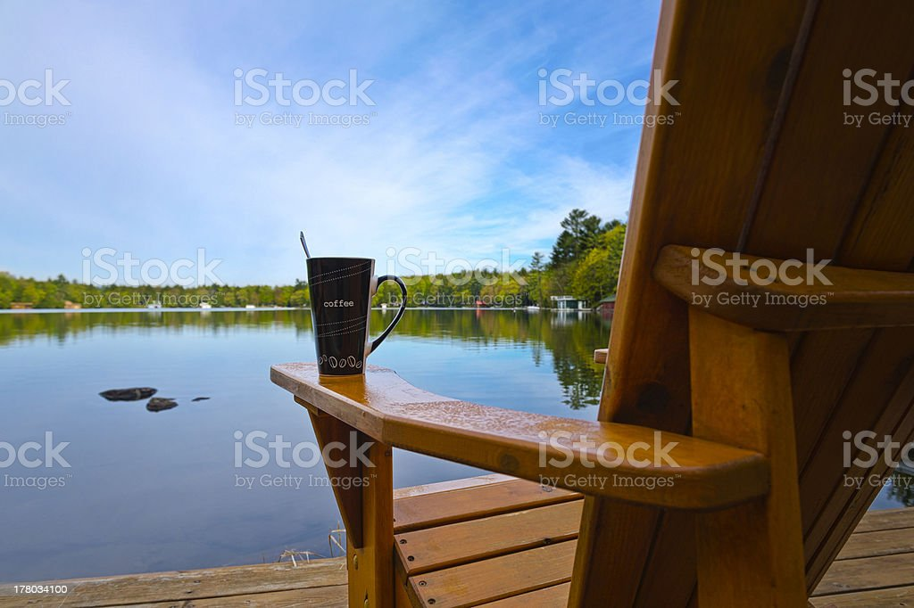 Coffee Mug on Muskoka chair stock photo