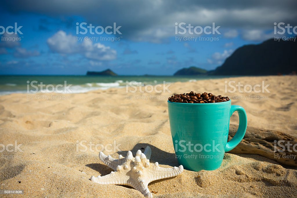 Coffee Mug on the Beach stock photo