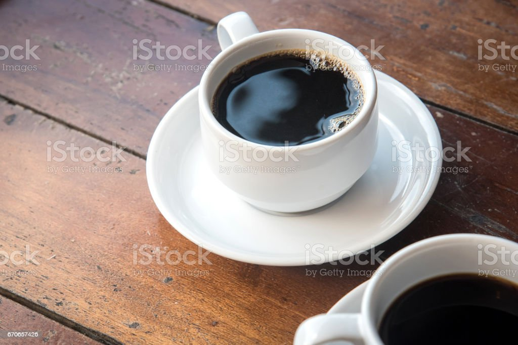 Coffee Mug on Wooden Table in the morning. stock photo