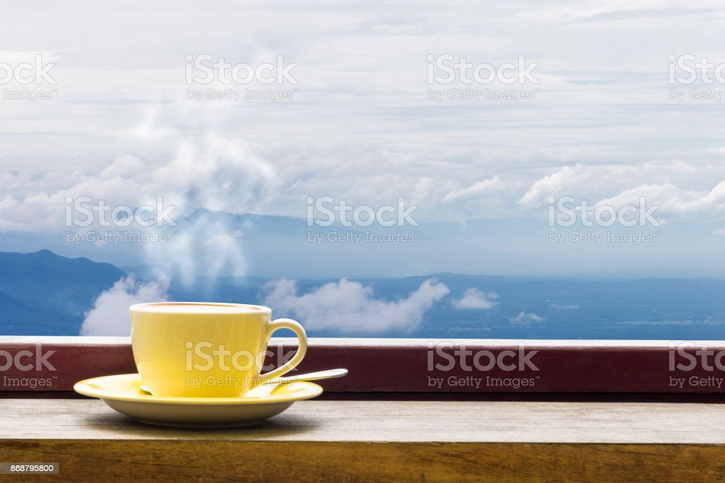Coffee Mug On Wooden Top Table In Arial View Of Mountian. stock photo
