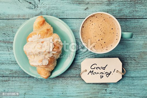 istock Coffee mug with croissant and notes good morning 511315878