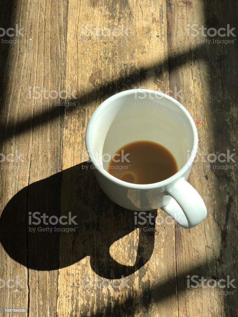 Coffee mug with shadow stock photo