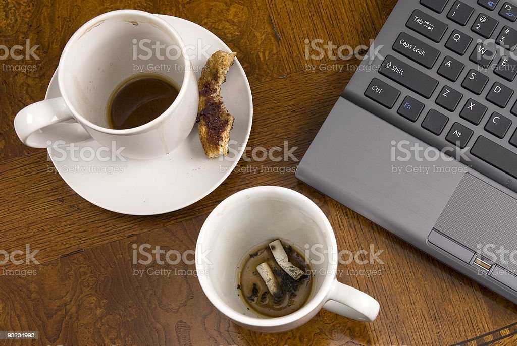 Coffee mugs and stress with laptop royalty-free stock photo