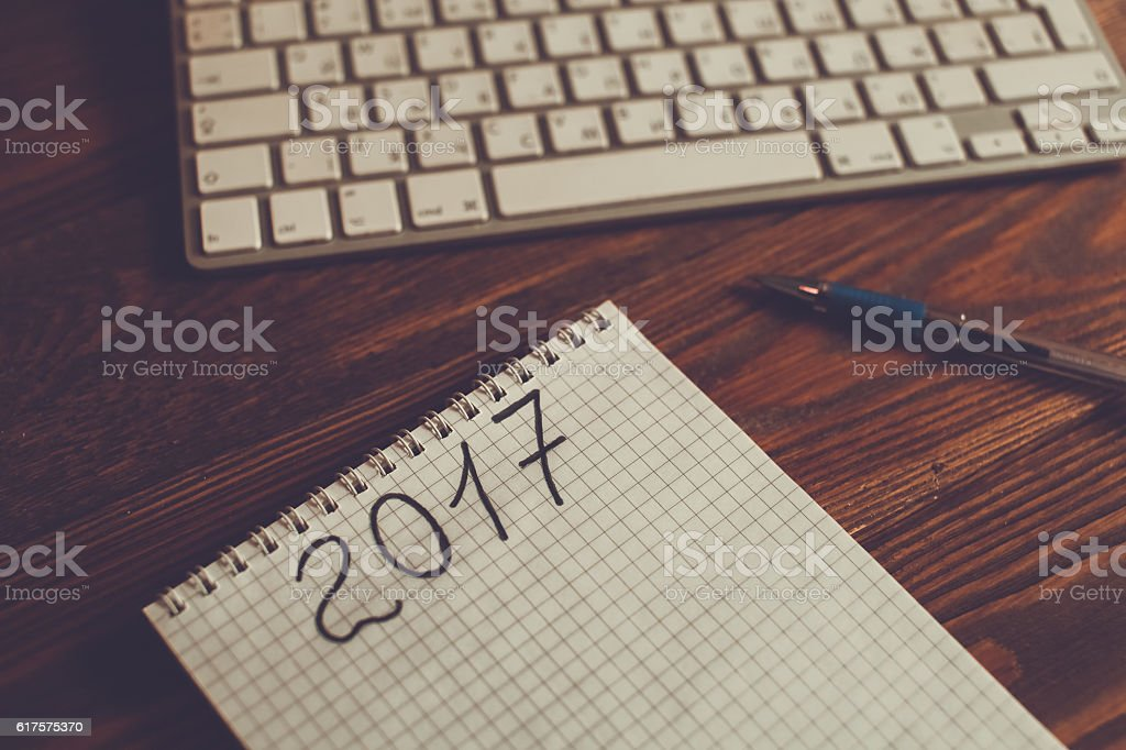 Coffee, notebook and keyboard on a dark wooden table royalty-free stock photo