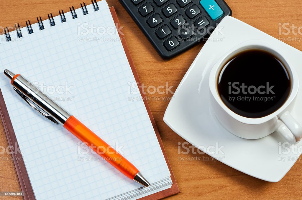Coffee, notepad with pen and calculator on work-table. royalty-free stock photo