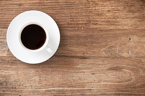 Coffee on a distressed wooden table stock photo