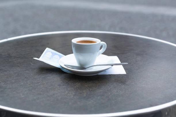 Coffee on a Parisian table and European Bill stock photo