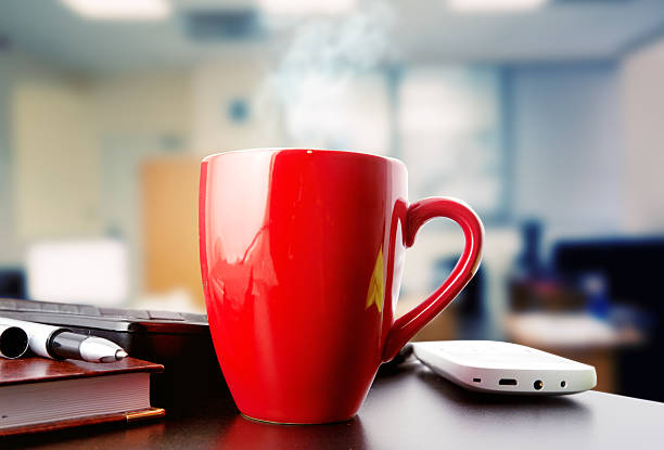 coffee on a table in office stock photo