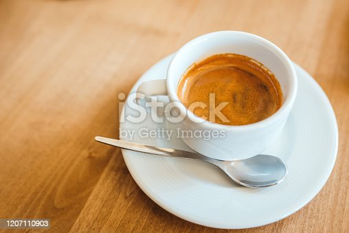Coffee on a wooden cafe table