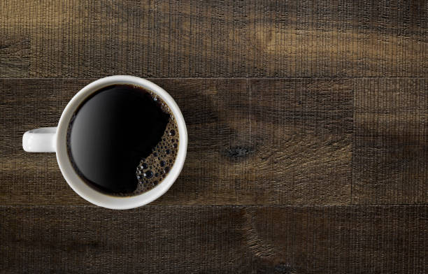 Coffee on a wooden table Coffee mug on a wooden table black coffee stock pictures, royalty-free photos & images