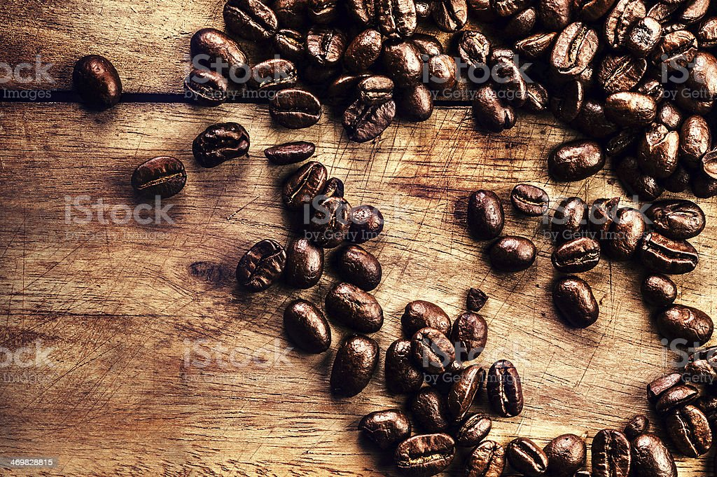 Coffee on grunge wooden background closeup. Roasted  coffe bean royalty-free stock photo