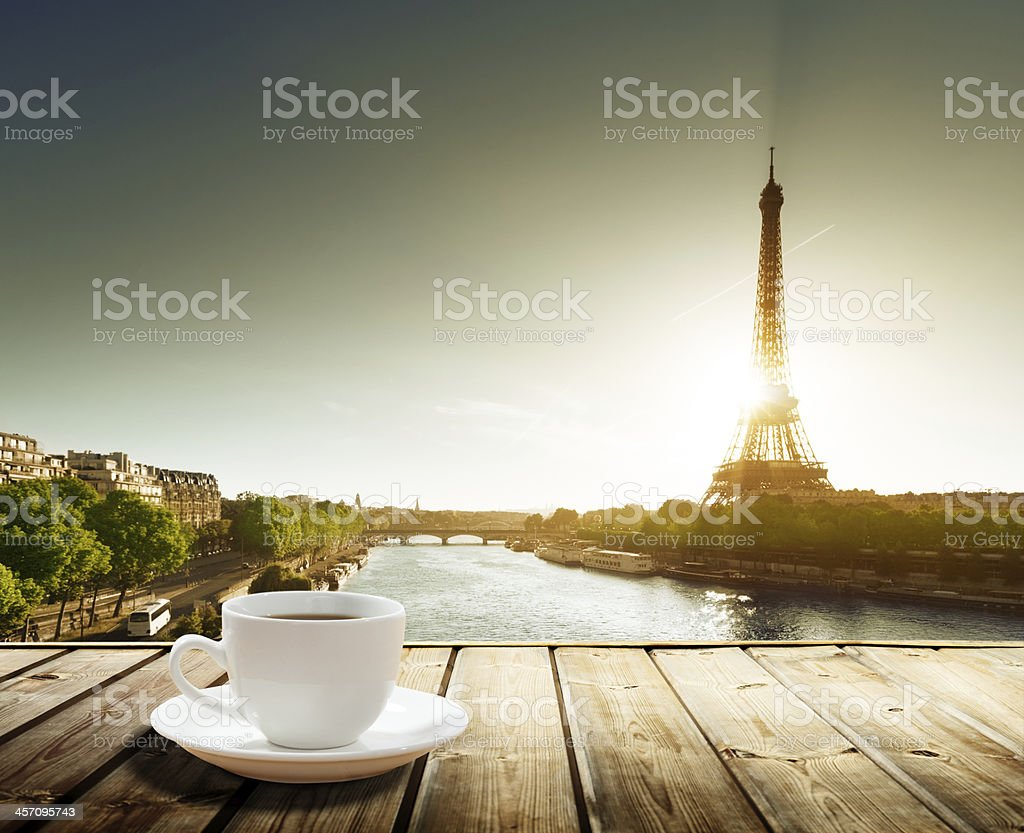 coffee on table and Eiffel tower in Paris stock photo