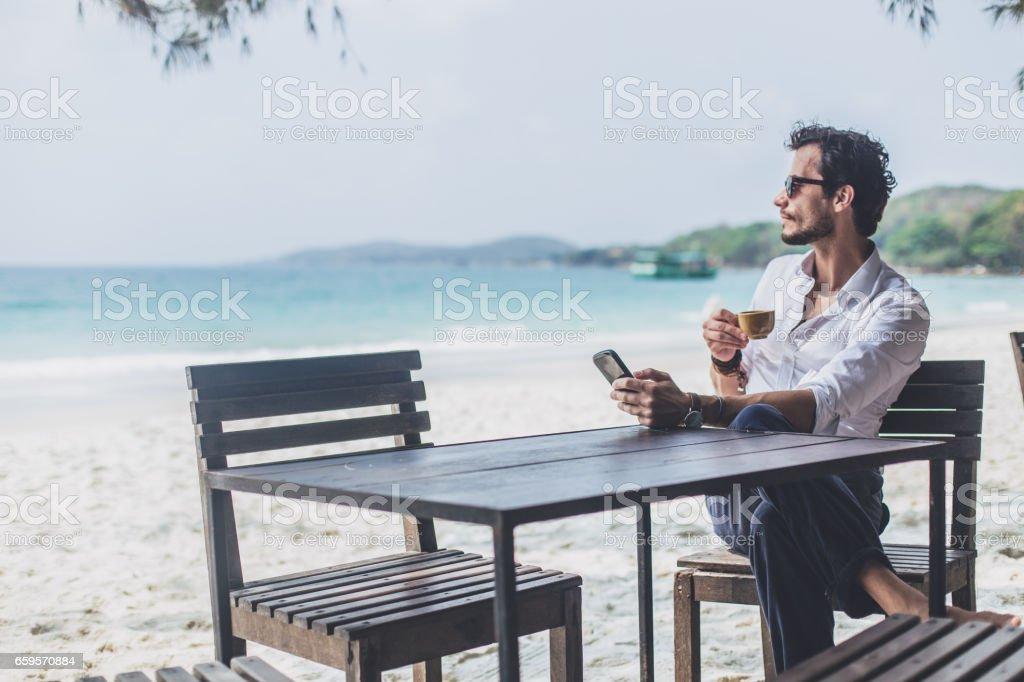 Coffee on the beach alone stock photo