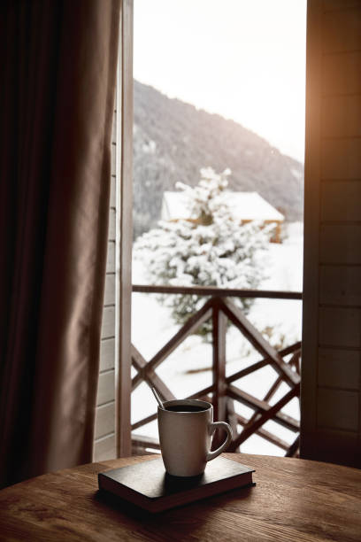 Coffee on the table with beautiful Mountain View stock photo