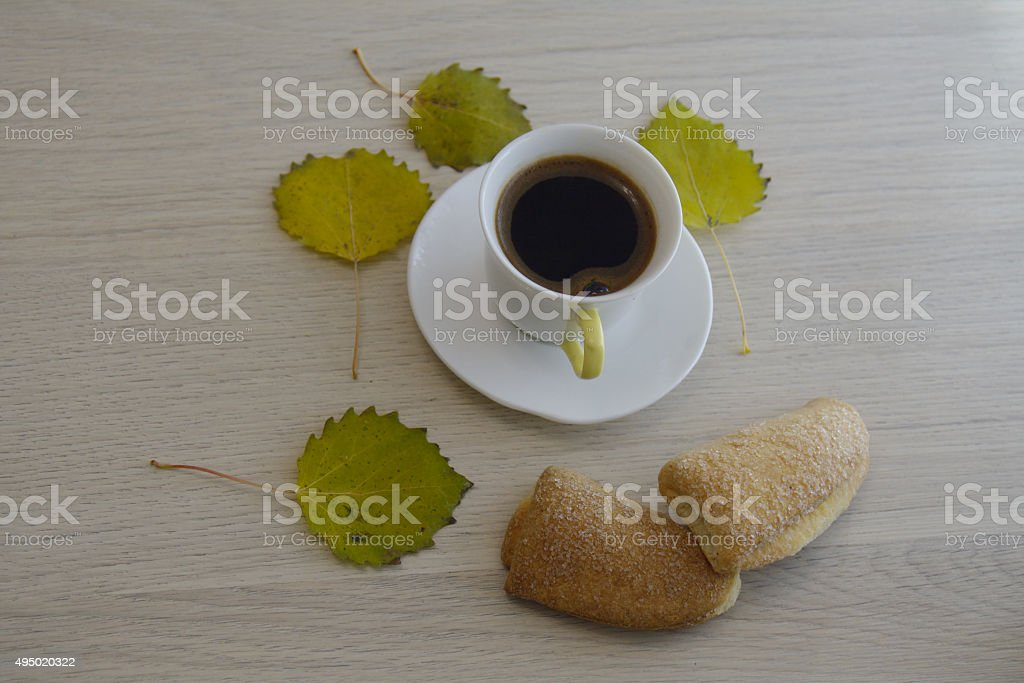 coffee on the table with yellow aspen leaves stock photo