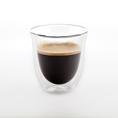 The glass of coffee isolated on white background. Top view at an angle. For design.