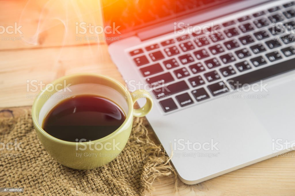 coffee on wood table background, salary man wake up morning with coffee, work at home concept. stock photo