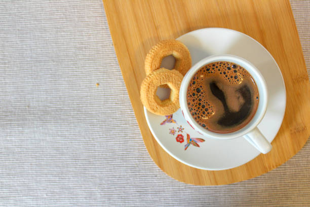 Coffee on wooden plate stock photo