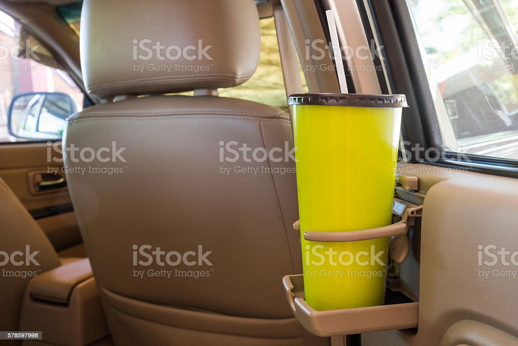 Coffee or tea mugs green placed on the vehicle console stock photo