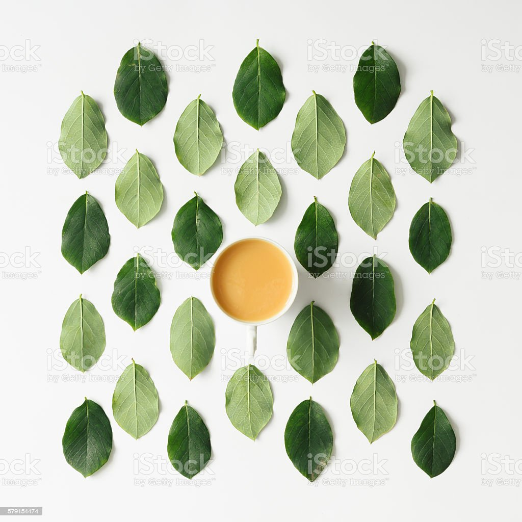 Coffee or tea on green leaves pattern stock photo