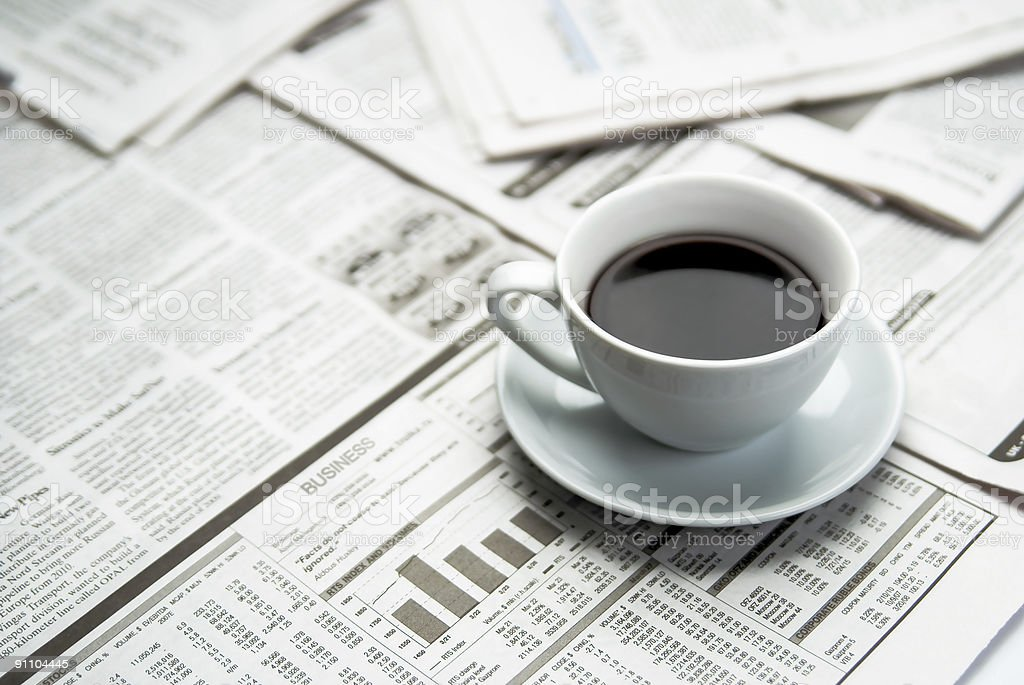 Coffee over newspaper stock photo
