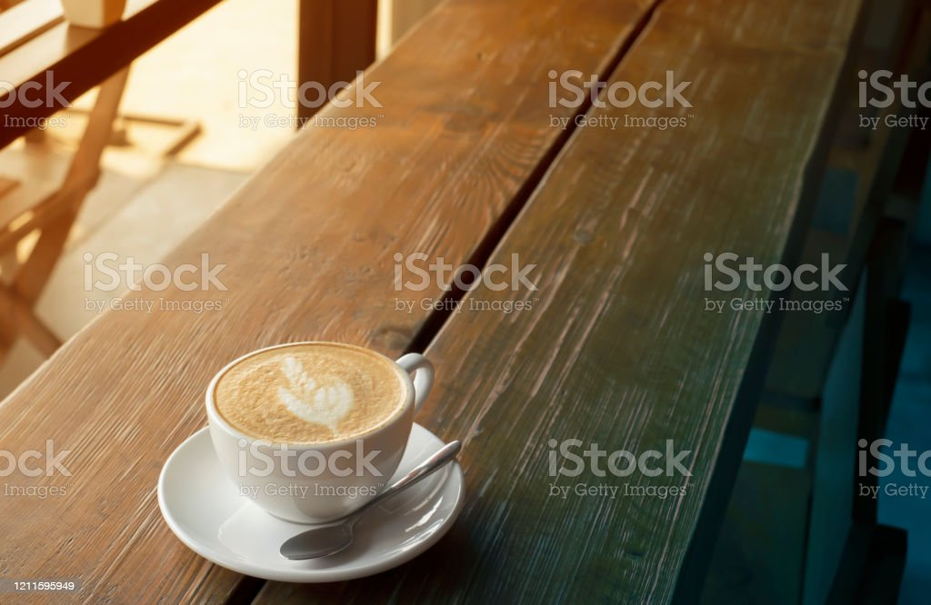 Coffee Photography With Luxury Coffee Cup Set Vintage White Color With Latte Art Coffee Decoration With Stainless Spoon On The Old Dark Retro Wooden Table Feeling Calm In The Morning Stock Photo