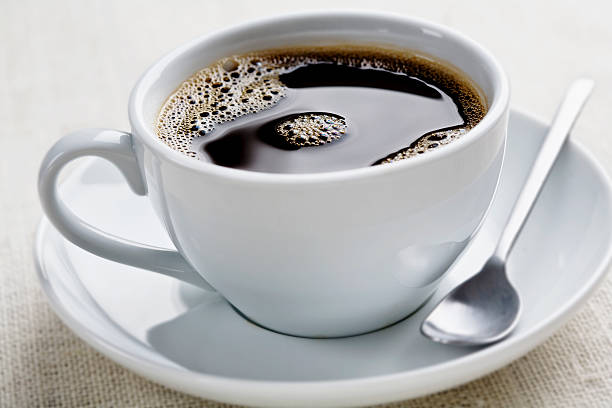 coffee cup of freshly brewed black coffee, focus is on the middle bubbles black coffee stock pictures, royalty-free photos & images