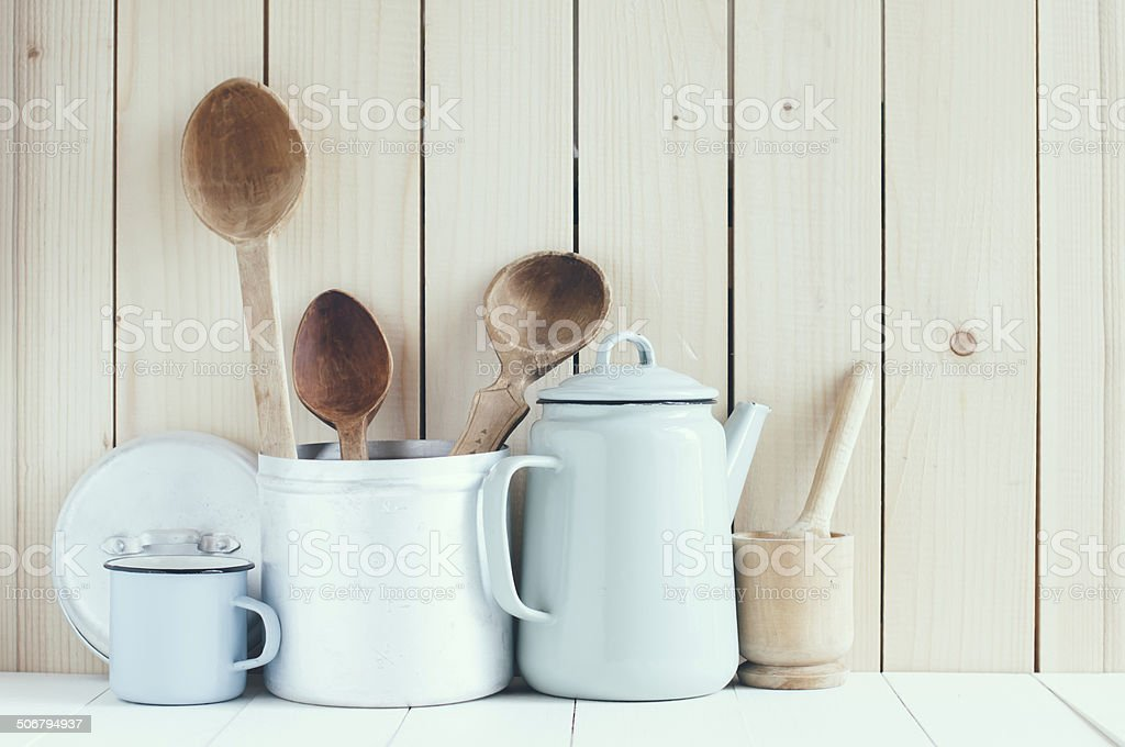 coffee pot, enamel mugs and rustic spoons stock photo