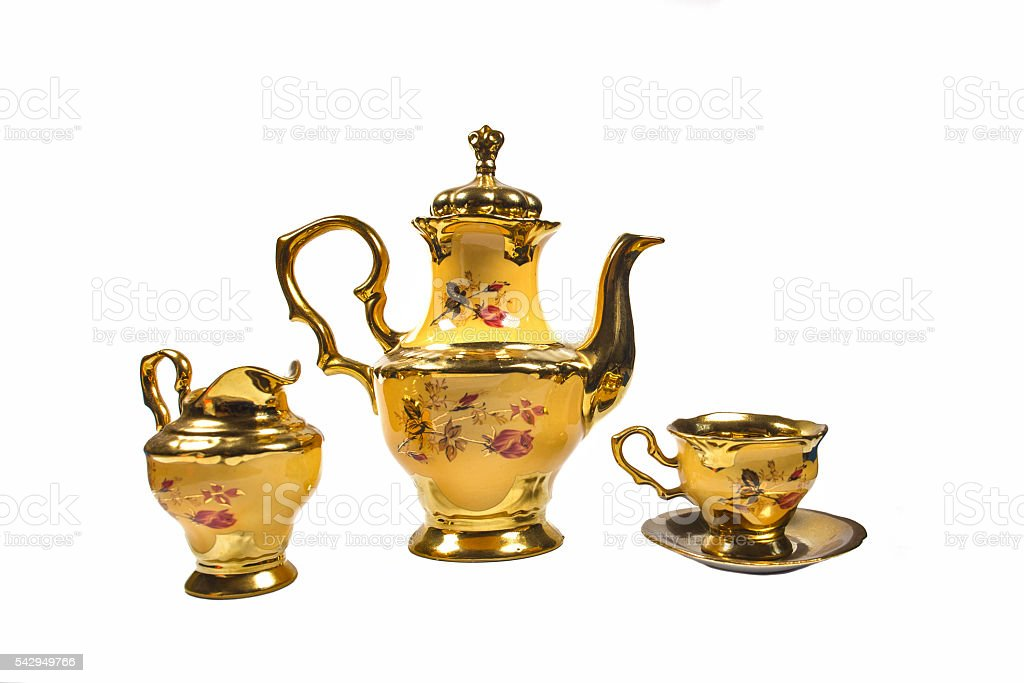 coffee pot maker Cup jug porcelain yellow gold plated. stock photo