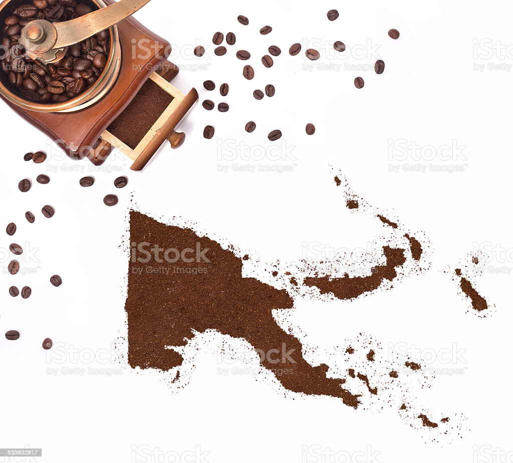 Coffee powder in the shape of Papua New Guinea.(series) stock photo