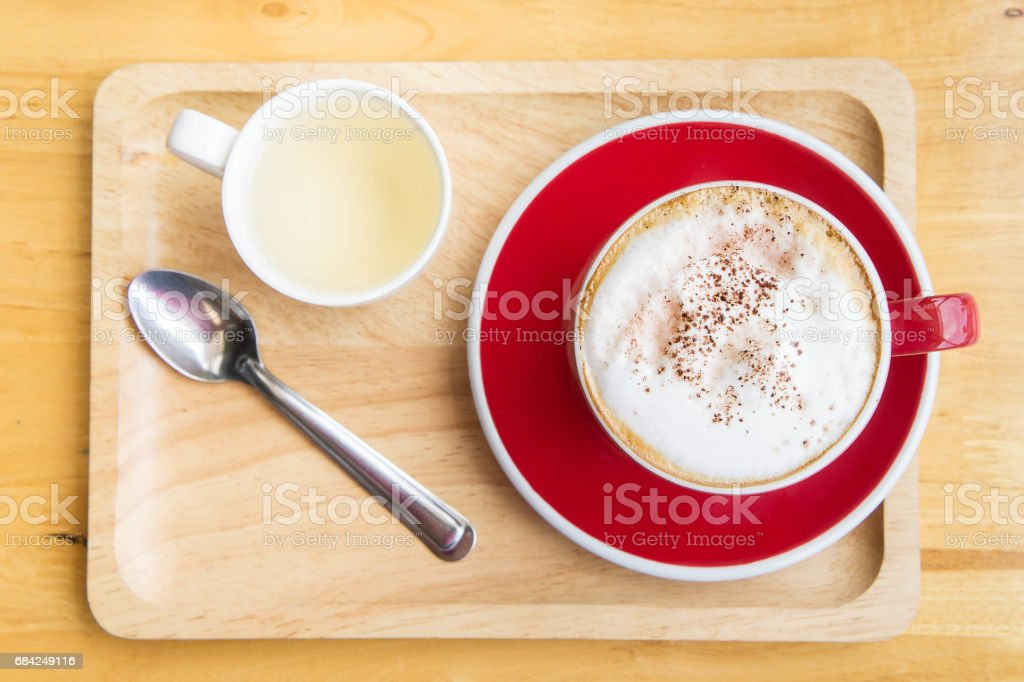coffee red cup on wood table in coffee shop royalty-free stock photo