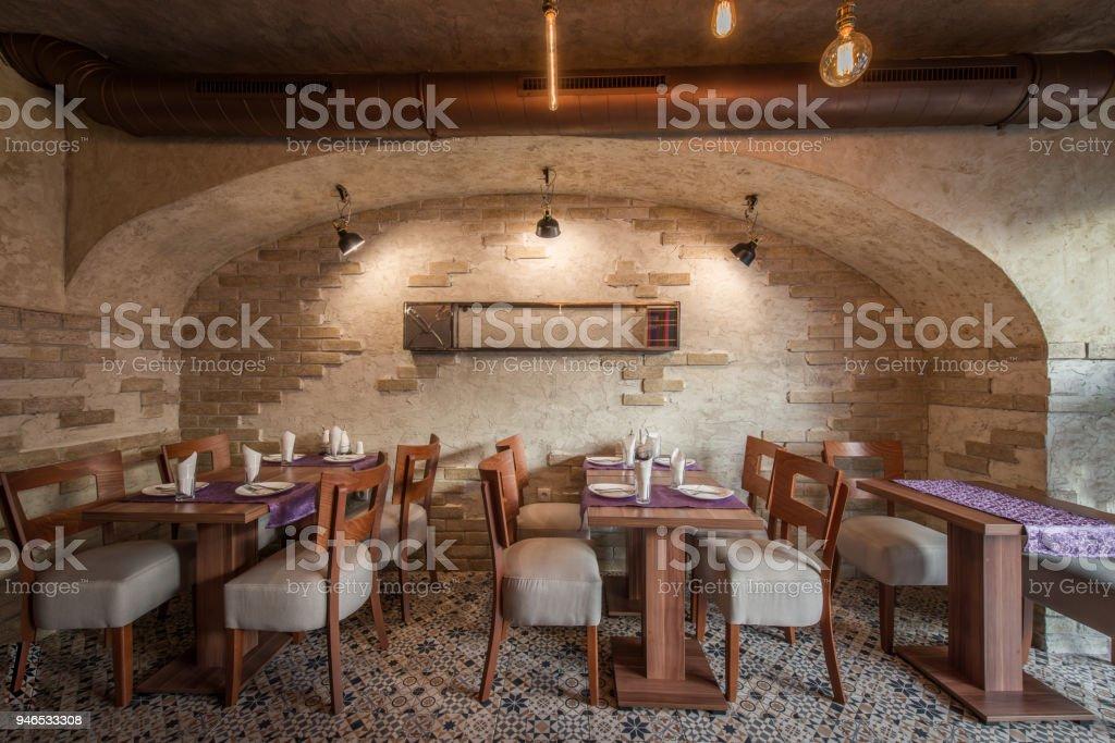 Coffee restaurant interior wit hbrick walls stock photo