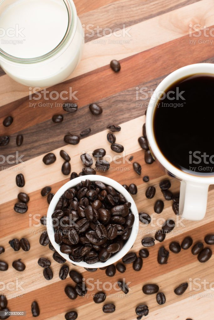 Coffee, roasted beans, and cream. stock photo