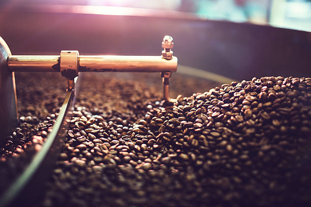 coffee roaster cooling batch of beans - coffee stock pictures, royalty-free photos & images