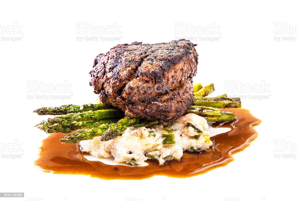 Coffee rubbed tenderloin beef with asparagus on white background stock photo